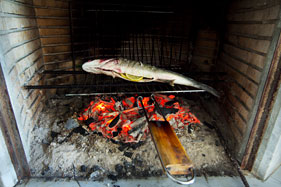 Char-grilling fish in the kitchen